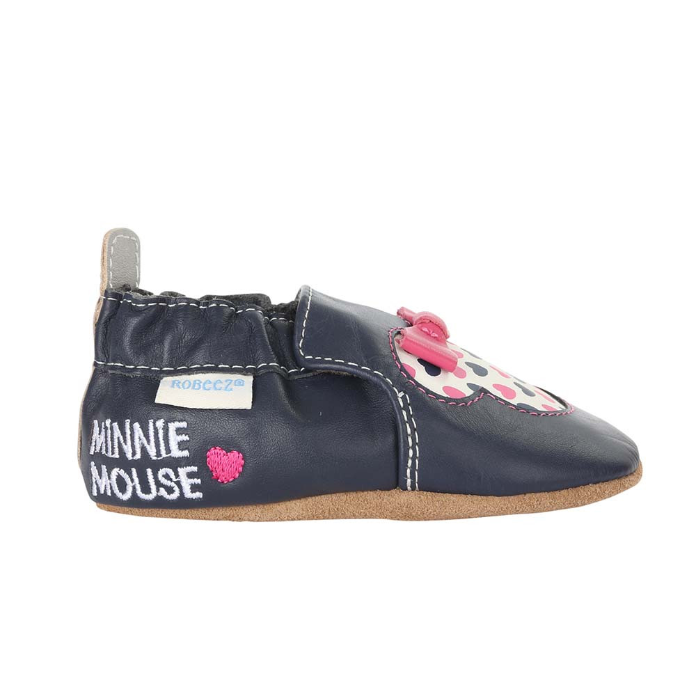Single side view of Disney Minnie Girl Baby Shoes, a crib shoe in navy leather featuring Disney's Minnie Mouse.