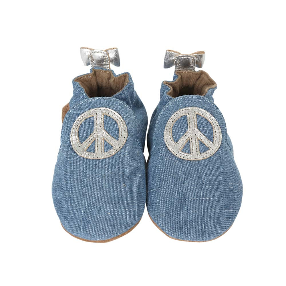 Front view of Peace Out Baby Shoes, a girls crib shoe in blue denim with silver leather peace sign.