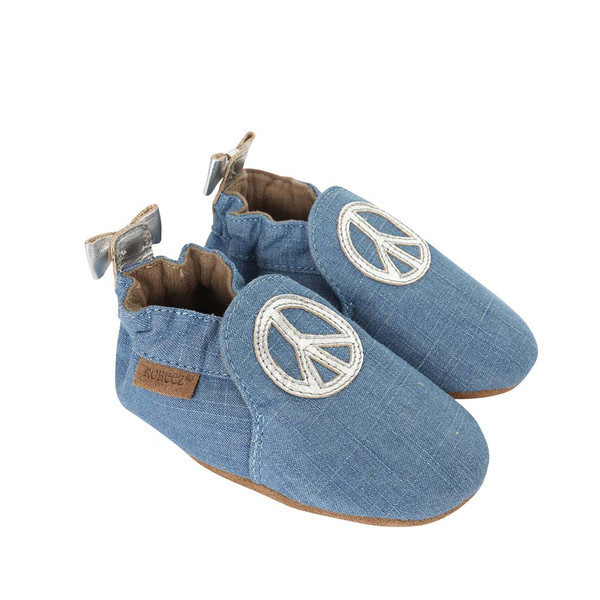 Side view of Peace Out Baby Shoes, a girls crib shoe in blue denim with silver leather peace sign.