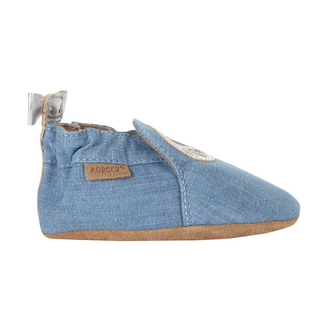 Single side view of Peace Out Baby Shoes, a girls crib shoe in blue denim with silver leather peace sign.