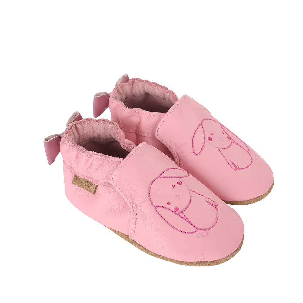 Side view of Sweet Bunny Baby Shoes, a soft soled girls crib shoe in pink leather with an embroidered bunny.