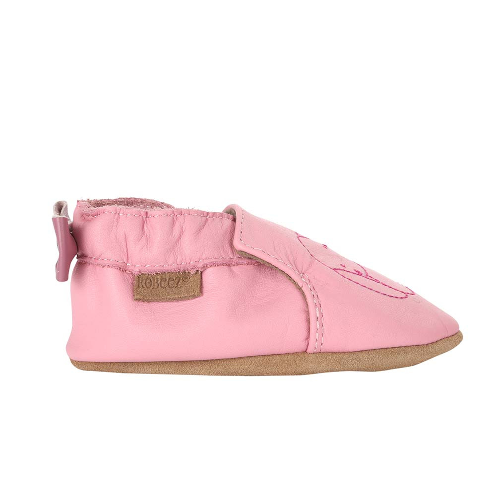 Single side view of Sweet Bunny Baby Shoes, a soft soled girls crib shoe in pink leather with an embroidered bunny.