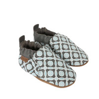 Side view of Khloe Baby Shoes, a soft soled baby shoe for girls in grey leather screen printed with a geographic pattern
