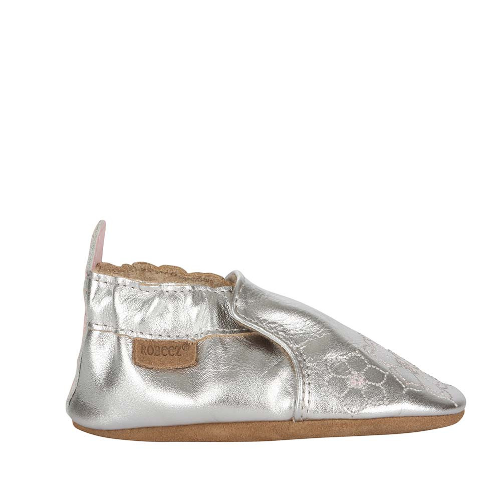 Single side view of silver soft soled crib shoes for girls ages 0 -2 years old.  Feature embroidered flowers.