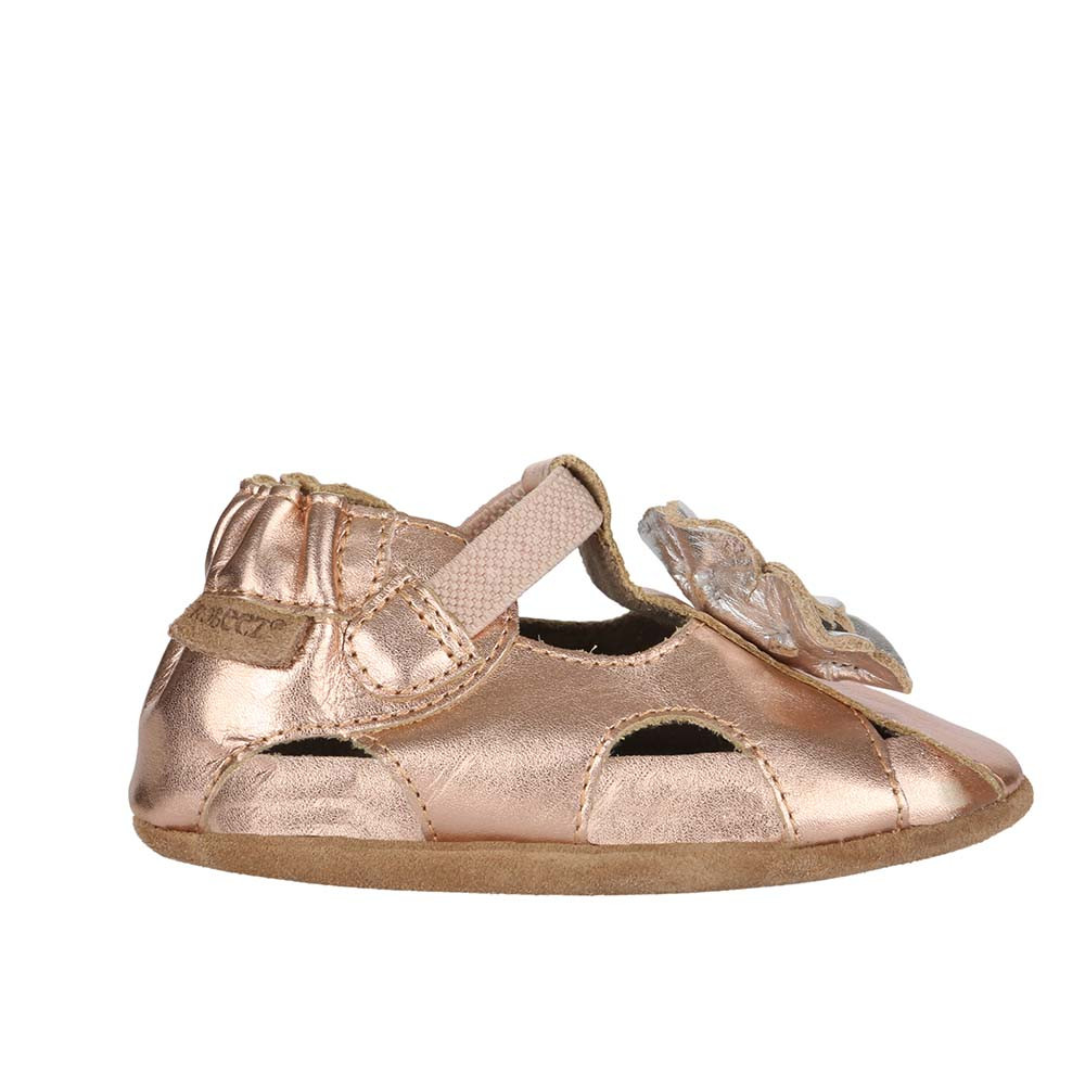 Single Side Pretty Pansy Gold Soft Soles: This gold sandal features a silver flower on it's toe.
