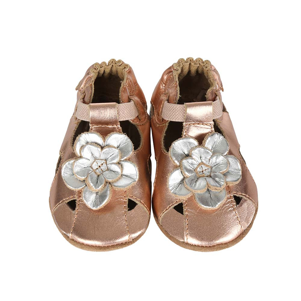 Front Pretty Pansy Gold Soft Soles: This gold sandal features a silver flower on it's toe.