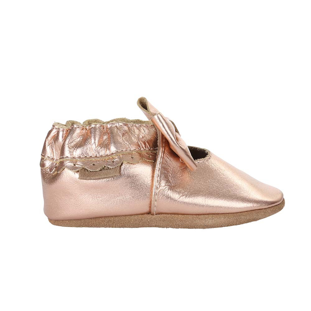 Single side view of Rosie Moccasins, a soft soled baby shoe for girls in rose gold leather.  These baby shoes come in sizes 0 - 24 months.