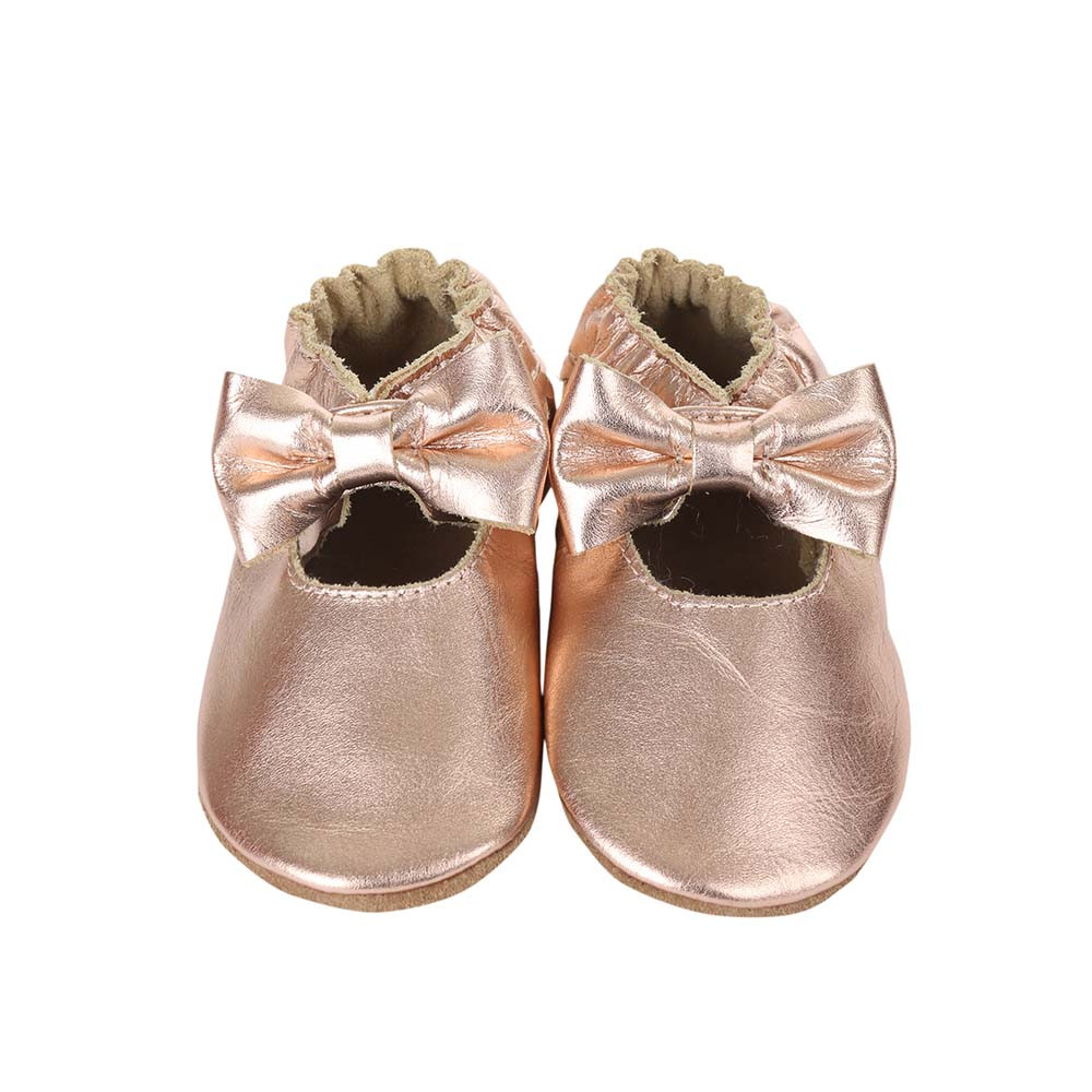 Front view of Rosie Moccasins, a soft soled baby shoe for girls in rose gold leather.  These baby shoes come in sizes 0 - 24 months.