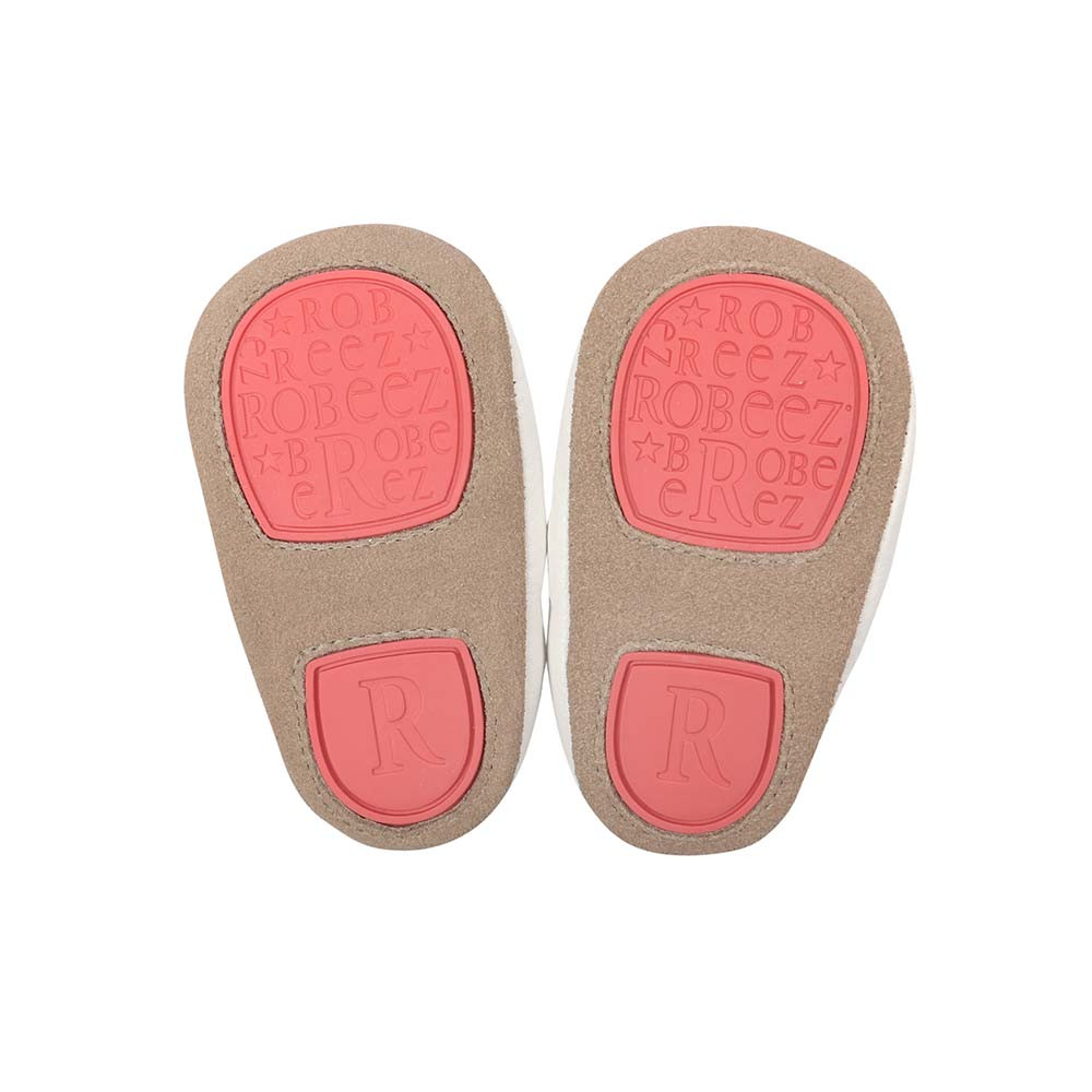 Split rubber outer sole provides added support for beginner walkers.