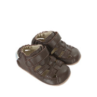 Side view of Brown Baby Sandal, a children's sandal for boys and girls.  Ages 0 -2 4 months.  Split rubber out sole provides added protection for beginner walkers.