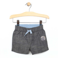 Grey woven shorts with elastic waste and faux drawstring for baby and toddler boys. Front view.