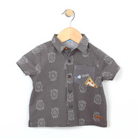 Grey cotton button front woven shirt screen printed with bagels and features a pizza applique.  For baby and toddler boys. Front view.