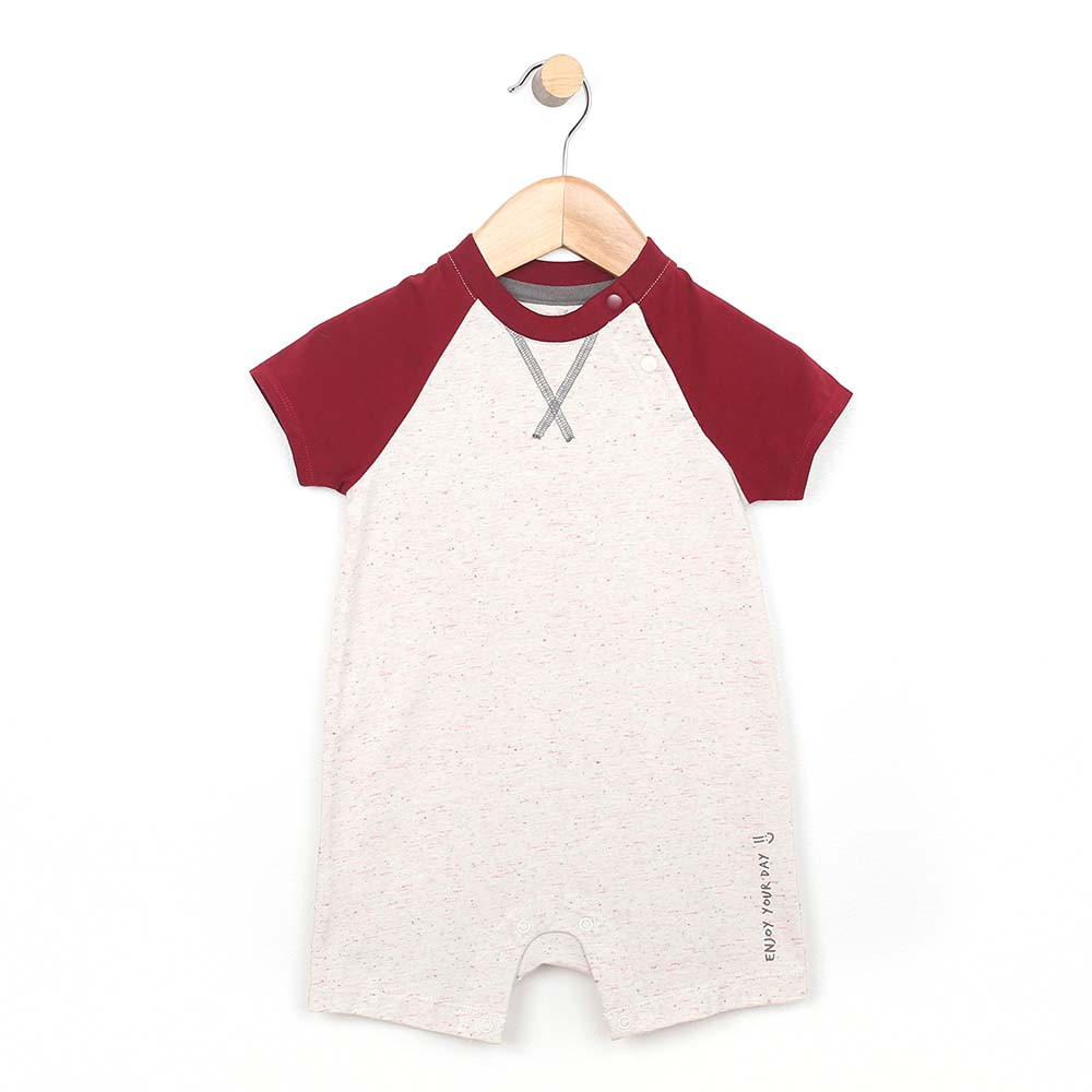 White cotton romper with red sleeves and collar for baby and toddler boys.  Front View.