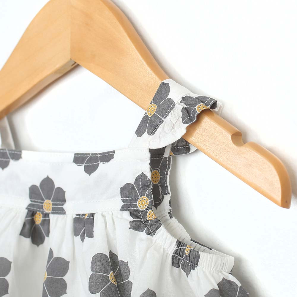 White cotton dress with grey and yellow flowers for baby and toddler girls.  With Diaper Cover.  Detail View.