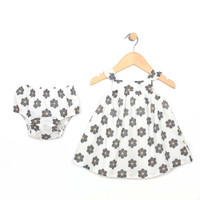 White cotton dress with grey and yellow flowers for baby and toddler girls.  With Diaper Cover.  Front View.