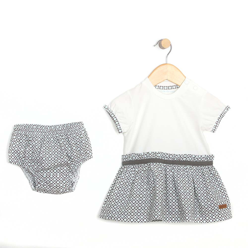 Cotton dress with diaper cover for baby and toddler girls.  White top and aqua and grey geometric skirt. Front View.