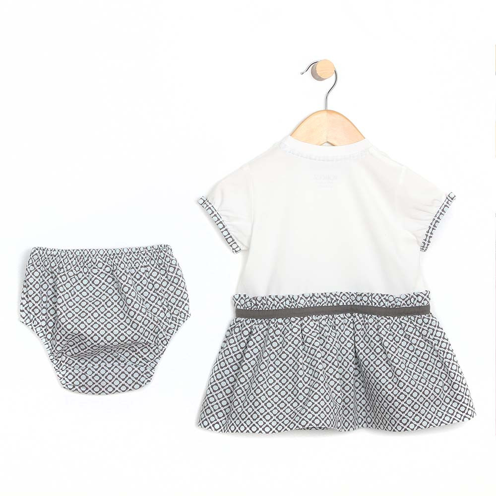 Cotton dress with diaper cover for baby and toddler girls.  White top and aqua and grey geometric skirt. Back View.