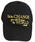 """Be the change you wish to see in the world"" and spread that message everywhere you go when you sport this black, National Civil Rights Museum message cap quoted by human rights activist Mahatma Gandhi.  Features of this cap are:   - Black cap with Gold embroidery  - NCRM Brand logo inside of cap band"