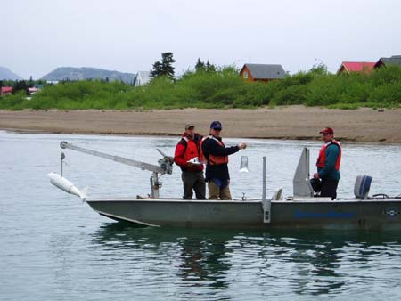 U.S. Geological Survey D-96 sampler being deployed from boat.