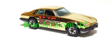 Hot Wheels Jaguar XJS, 1979 Gold Machines 6-pack, blackwall wheels, Hong Kong base, loose