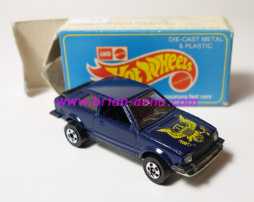 Hot Wheels Leo India Mattel Ford Escort, Dark Blue, Yellow Eagle tampo, BW wheels, box