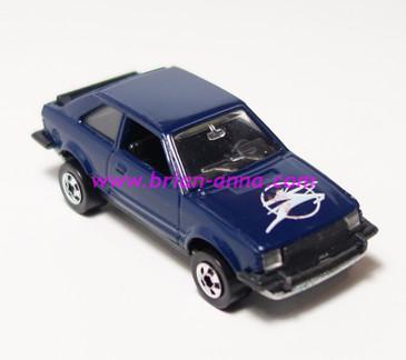 Hot Wheels Leo India Mattel Ford Escort, Dark Blue, w/Pierce Arrow style hood tampo, BW wheels, loose
