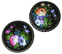 Assorted shapes: round, oval, heart, and rectangular. Each brooch is a handpainted original design so details and colors will vary. Standard designs are black with multi-colored flowers.