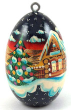 """Hand painted on wood, this  ornament has accents of 24 kt gold leaf which shine and sparkle on the depicted Winter Village Scene. This is a beautiful, and sturdy addition to your Christmas tree! Approx 2.2"""" tall, sizes vary as they are each hand made"""
