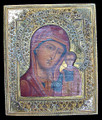 This icon shows normal age crazing of the painting and is in very good condition with a minor chipping of the paint in the lower left corner where the painting and riza meet. The brass cover has elaborate style decoration and is in excellent condition.