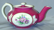 "This piece is in excellent condition with no chips or cracks in the porcelain. The teapot is approximately 8.5"" long and 4.5"" tall."