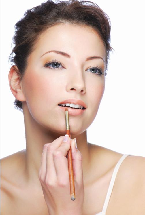 woman-applying-lip-color.png