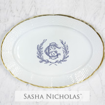 A beautiful addition to your dinnerware collection and to adorn your tablescapes with. It makes the perfect gift for your wedding registry and has the option to include an inscription on back. Choose from their signature font styles or use a custom monogram or crest of your choice! | Sasha Nicholas's white porcelain weave 24K gold oval platter