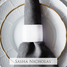 A beautiful addition to your dinnerware collection and to adorn your tablescapes with. It makes the perfect gift for your wedding or gift registry. | Sasha Nicholas's white porcelain oval napkin ring