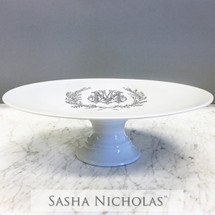 A beautiful addition to your dinnerware collection and to adorn your tablescapes with. It makes the perfect gift for your wedding or gift registry. Choose from their signature font styles or use a custom monogram or crest of your choice! | Sasha Nicholas's white cake plate