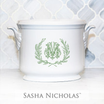 A beautiful addition to your dinnerware collection and to adorn your tablescapes with. It makes the perfect gift for your wedding registry and has the option to include an inscription on back. Choose from their signature font styles or use a custom monogram or crest of your choice! | Sasha Nicholas's white porcelain champagne bucket