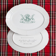 A beautiful addition to your dinnerware collection and to adorn your tablescapes with. It makes the perfect gift for the holidays with the included handwritten inscription on back. The pine green stag crest is a holiday classic. | Sasha Nicholas's white porcelain oval platter