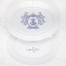 A beautiful addition to your dinnerware collection and to adorn your tablescapes with. It makes the perfect gift for your wedding registry with the included handwritten inscription on back. The Fleur De Lis Crest is a stunning classic. | Sasha Nicholas's white porcelain oval platter