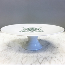 A beautiful addition to your dinnerware collection and to adorn your tablescapes with. It makes the perfect gift for the holidays with the included inscription on bottom. The pine green stag crest is a holiday classic. | Sasha Nicholas's white porcelain cake plate