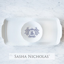 A beautiful addition to your dinnerware collection and to adorn your tablescapes with. It makes the perfect gift for your wedding registry with the included inscription on back of the platter. The Fleur De Lis Crest is a stunning classic. | Sasha Nicholas's white porcelain hostess platter and petite bowl