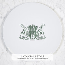 A beautiful addition to your dinnerware collection and to adorn your tablescapes with. It makes the perfect gift for the holidays with the included inscription on back. The pine green stag crest is a holiday classic. | Sasha Nicholas's white porcelain holiday charger