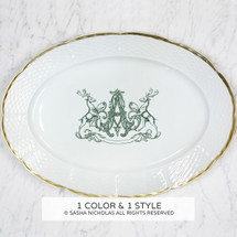 A beautiful addition to your dinnerware collection and to adorn your tablescapes with. It makes the perfect gift for the holidays with the included handwritten inscription on back. The pine green stag crest is a holiday classic and the 24K gold rim is quite stunning. | Sasha Nicholas's white porcelain 24K gold oval platter