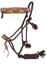 Showman Woven brown nylon mule tape halter with hand painted sunflower and cactus noseband. This mule tape style halter features woven nylon with a removable 8' lead. Features a wide leather noseband with hand painted sunflower and cacuts noseband and two copper conchos, tassel end at the tie point ane tassels on the removable lead. Halter is lightweight and excellent for ground work or any other in-hand training.  FREE SHIPPING IN THE USA!  All others pay cost of shipping.   THANK YOU!