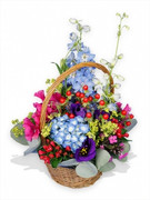 blue hydrangeas, sweet peas, purple lisianthus, berries, phlox and delphiniums