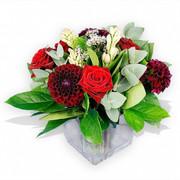 red Grand Prix roses, burgundy dahlias, tuberose and lush foliage that include baby blue eucalyptus