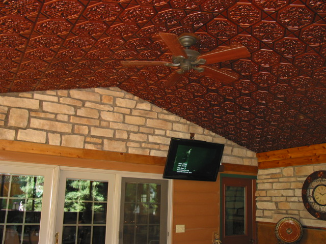 enclosed patio with french doors stone walls and antique copper ceilings