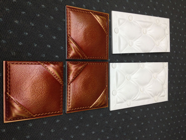 Faux leather tiles cut in half to show how clean of a cut can be achieved with a miter saw.