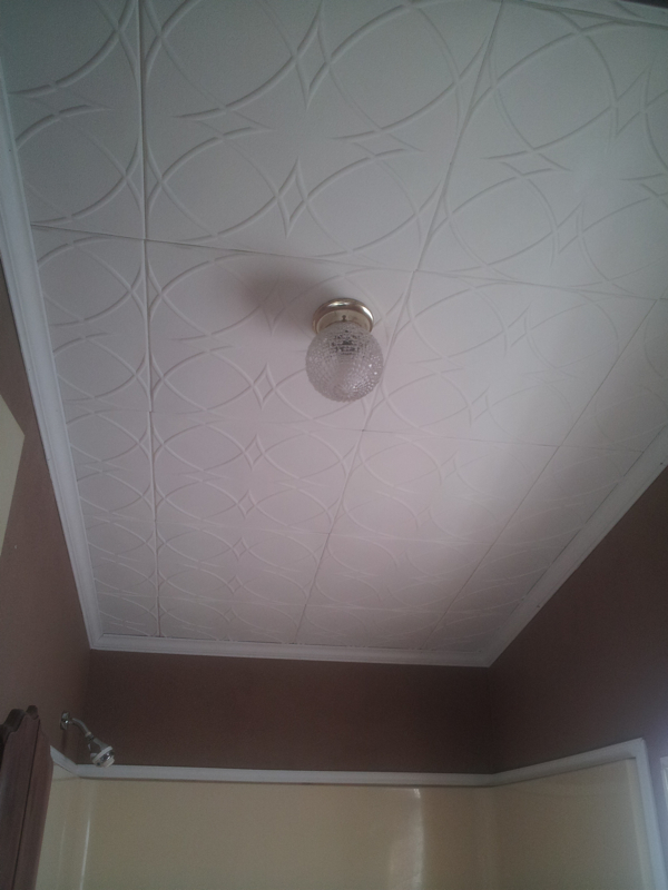 Our R82 Styrofoam Ceiling Tiles installed in a bathroom with brown walls.