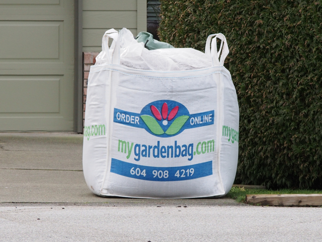White MyGardenBag on driveway