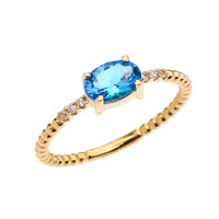 Diamond Beaded Band Ring With Blue Topaz Centerstone in Yellow Gold