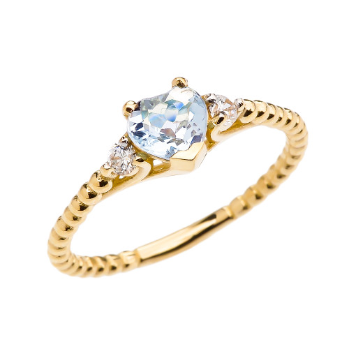 aquamarine solitaire and white topaz yellow gold